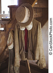 Vintage Amish garments hanging from stairs