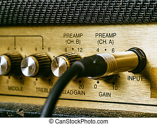 Vintage amplifier knobs and input - Macro photo of a vintage...