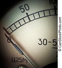 Vintage analog measurement dial with arrow at zero position, closeup. Shallow DOF.