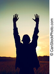 Praying Man - Vintage and Toned Photo of Praying Man on the...