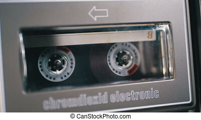 Vintage Audio Cassette in the Tape Recorder Playing and...