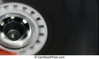 vintage audio cassette playing closeup, sliding camera movement