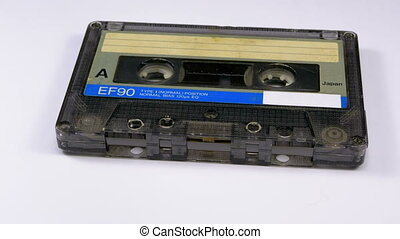 Vintage Audio Cassette Rotates on White Background