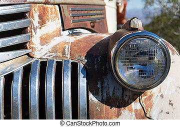 vintage automobile headlight closeup