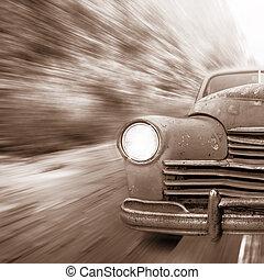 Vintage automobile moves fast.