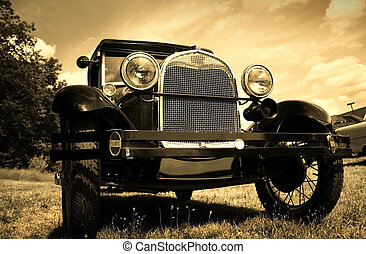 Vintage Automobile - Front view of classic car in sepia...