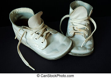 Vintage Baby Shoes - Vintage baby shoes over black.