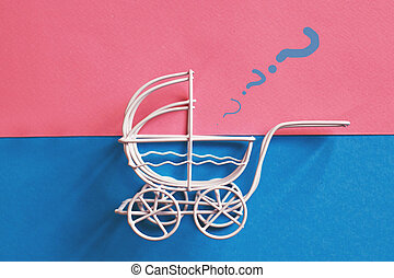 vintage baby stroller on pink and blue background. Boy or girl question