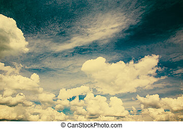 Vintage background in the blue shade with clouds