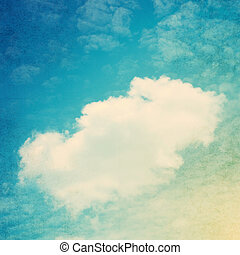 Vintage background in the blue shade with clouds.