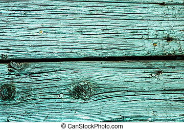 Vintage background of old boards painted in aquamarine