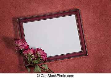 Vintage background with frame for photo and dry roses