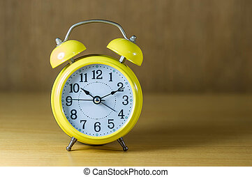 retro alarm clock on table - Vintage background with retro...