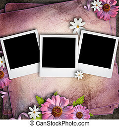 Vintage background with three retro blank photos and flowers