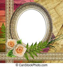Vintage baget frame on wooden background with roses, paper