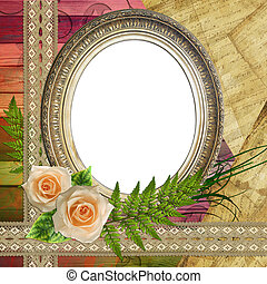 Vintage baget frame on wooden background with roses, paper