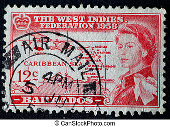 Vintage Barbados postage stamp of 1958 with image of Queen Elizabeth and plan of the Caribbean in red