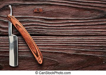 Vintage barber shop straight razor tool on wooden background...