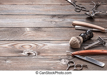 Vintage barber shop tools on wooden background - Vintage...