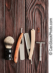 Vintage barber shop tools on wooden background