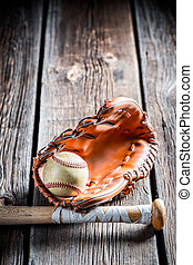 Vintage baseball ball and glove