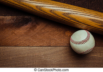 Vintage baseball gear on a wooden background