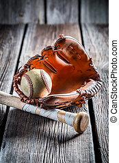 Vintage baseball glove and old ball