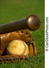 Vintage baseball on base - Vintage baseball with bat and...