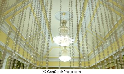 vintage beautiful crystal chandeliers on the ceiling, large ceremonial hall