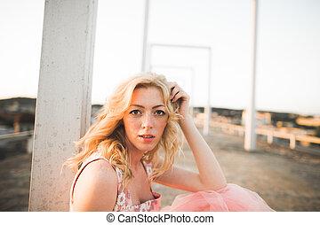 Vintage beautiful fashion girl posing on sunset