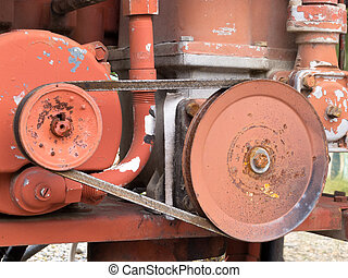Mechanical belt driven gear wheels on an engine for power transmission from one shaft to another