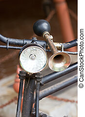 Vintage bicycle horn on handlebar.