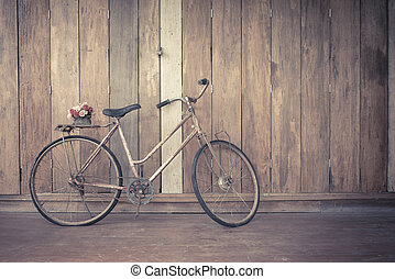 bicycle - vintage bicycle on wooden house wall