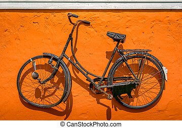 Vintage bike hanging on a wall