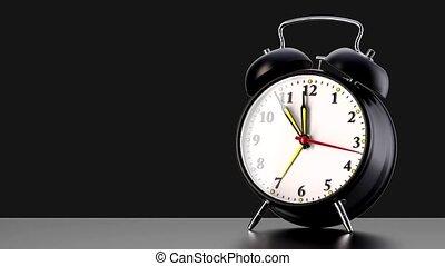 vintage black alarm clock on black background. Time concept....