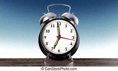 vintage black alarm clock on blue background. Time concept....