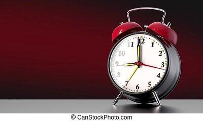 vintage black alarm clock on red background. Time concept.