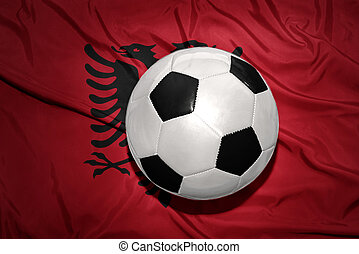 black and white football ball on the national flag of albania