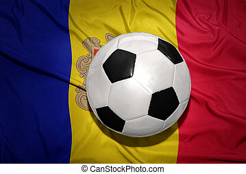 black and white football ball on the national flag of andorra