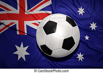 black and white football ball on the national flag of australia