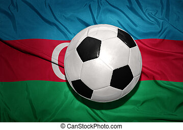 black and white football ball on the national flag of azerbaijan