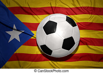 black and white football ball on the national flag of catalonia