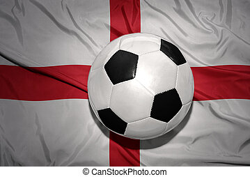 black and white football ball on the national flag of england