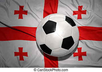 black and white football ball on the national flag of georgia