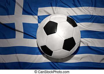 black and white football ball on the national flag of greece