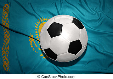 black and white football ball on the national flag of kazakhstan