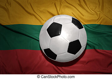 black and white football ball on the national flag of lithuania