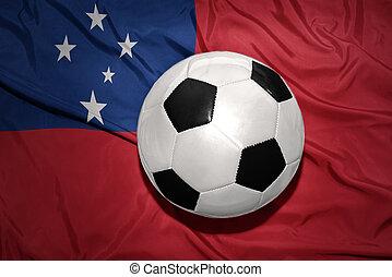 black and white football ball on the national flag of Samoa