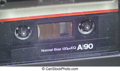 Vintage Black Audio Tape with White Blank Label is Rotates