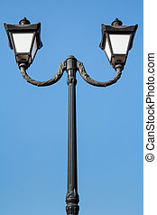 Vintage black street lamppost with two lamps
